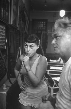"""Mickelsen Perel: Opera singer Roberta Peters (L) puffing a special device for singers called an """"air-o-mill."""" Jospeh Pilates on the right. Location: New York, NY, US Date taken:February 1951 Pilates Mat, Pilates Training, Pilates Reformer Exercises, Joseph Pilates, Pilates Instructor, Pilates Workout, Pilates Equipment, Yoga Movement, Yoga Dance"""