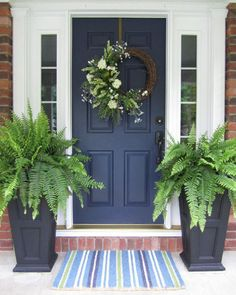 Navy blue front door with tall fern planters That's my brick. I never would have thought navy blue. I love it My Blue Front Door: front door color is Sherwin Williams Naval. The perfect navy blue for entry doors or a front door with sidelights. Best Front Doors, The Doors, Entry Doors, Navy Front Doors, Garage Doors, Dark Front Door, Entry Door With Sidelights, Beautiful Front Doors, Garage Door Makeover
