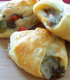 Philly Cheese Steak Crescent Bites - They have all the Philly cheese steak flavors, beef, peppers, onions and Provolone cheese. The ingredients are all wrapped up in a little crescent roll, delicious!