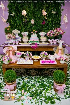 Fairy Garden Party. Pink, lilac, green and white. Party features: The desserts are wrapped in paper and served in pots to resemble flowers, while layers of ribbon get tied around the table. Along with lots of candy and flowers, look for Fairy Party Supplies, Clear Cellophane Bags, Ribbon, Lollipals Lollipops, Garden Themed Party Supplies.
