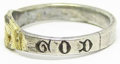 This is a magnificent medieval silver-gilt wedding ring, dating to the 14th century A.D. This ring combines a 'fede' with an early 'posy' ring, a rare and highly desireable combination. The silver ring is partially gilded on the bezel, formed as two hands clasped in union. The band of the ring has been engraved in Lombardic script with the words 'God help' in English. This is a protective inscription, designed to appeal for divine protection, for both the marriage and safety of the wearer.