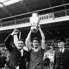 Cesare Maldini lifts the European Cup following Milan's win over Benfica at Wembley Stadium in 1963