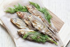 Fried River Fish And Dill On A Paper On A Wooden Background - Download From Over 38 Million High Quality Stock Photos, Images, Vectors. Sign up for FREE today. Image: 62395945