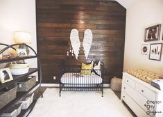 Wood Pallet Wall with Large Angel Hanging Wings - such a sweet, yet rustic nursery for baby!