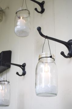 Use wall hooks to hang mason jars and create soft candle light on your outdoor porch - would love this on our deck
