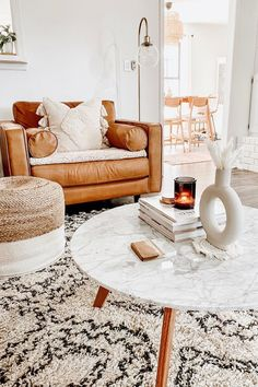 The Sven charme tan chair's corner blocked wooden frame will hold you up on good days and bad, and this piece vows to mix well with all of your design choices. With clean lines, a tufted seat and luxuriously stuffed back cushions, this piece is worth settling into. Photo by Madisn Goodno. #LivingRoomIdeas #LivingRoomDecor #ModernLivingRoom #ModernLiving
