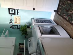 Blue laundry room, paint color and wall decor, laundry room basket holder, clothes pin art.