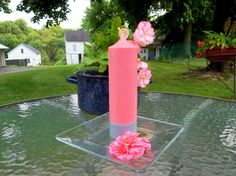 """Pastel pink and gray soy pillar candle with dome shaped head size: 21/4""""x 8"""".Pink is for calm feelings, to neutralize disorder, for relaxation, acceptance and contentment. Pink is also symbolizes femininity.This soft and fluffy soy pillar candle is romantic and delicious if that may be said about candles. It calls for rejuvenating your home with artistically placing it with flowers or any other objects of beauty. When lit it will burn in soft steady clean flame and will add romance calm and…"""