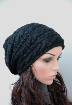 Something I would love to make for myself...but, I can only find it premade at the following website. If someone finds a pattern, please post it. I would love to have it. Thank you. http://www.artfire.com/ext/shop/product_view/maxmelody/5303637/hand_knit_hat_-_navy_hat_slouchy_hat_cable_pattern_hat/handmade/accessories/hats/cloche