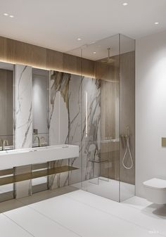 The slatted feature wall ends inside the shower enclosure, where a gold rainfall shower head descends from the ceiling.