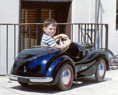 Young motorist in an Austin pedal car circa 1949. From a set of 35mm Kodachromes I acquired in northern New Jersey.
