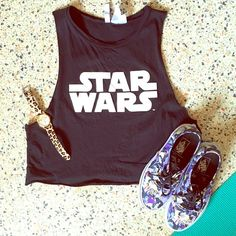 Star Wars Crop Muscle Tee Black muscle crop tee with the iconic Star Wars logo emblazoned across the front! Bring out your inner geek  with this awesome tee! Divided Tops Crop Tops