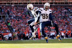 Eric Weddle #32 of the San Diego Chargers celebrates his 23 yard interception for a touchdown with Shaun Phillips #95