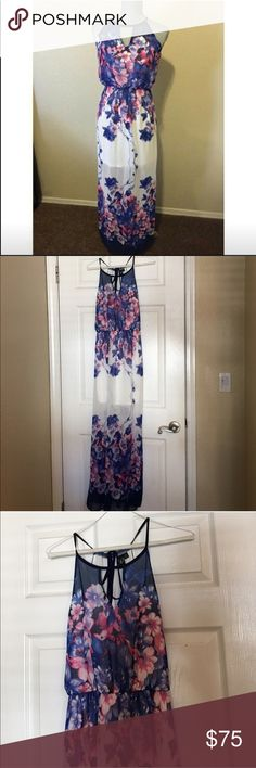 Windsor • White Floral Dress Cute white and Floral dress • size small • true to size • good condition • dress has a lining • 100% polyester• slit on one side as shown in photo• ties in the back at the top • absolutely stunning    • Offers Welcome • Bundle Discounts  • Suggested User • Fast Shipper Windsor Dresses