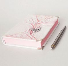 White leather notebook #diary with #pink tree of life and silver #butterfly in front, with pink inside, an unique gift for girls and women. The writing journal planner it's also perfect for the best friend, or bridesmaid.... Leather Notebook, Leather Books, Leather Journal, Diary For Girls, Unique Gifts For Girls, Creative Notebooks, Leather Photo Albums, Pink Trees, Life Planner