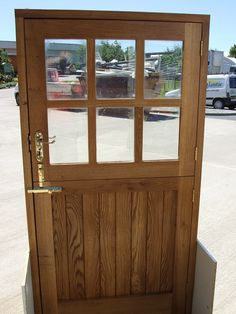 Oak stable door with chunky traditional glazing bars to top leaf