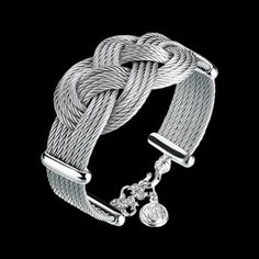 Charriol Celtic Love Knots bracelet    Eight rows stainless steel and titanium cables, palladium plated silver decors, security clasp.