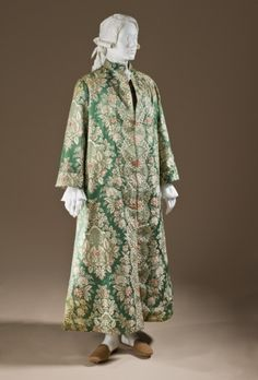 Man's At-home Robe (Banyan) and Waistcoat France, circa 1720 Costumes; ensembles Silk satin with silk supplementary-weft patterning a) Robe center back length: 29 1/4 in. (74.3 cm); b) Waistcoat center back length: 55 3/4 in. (141.61 cm) Costume Council Fund (M.2010.90a-b)
