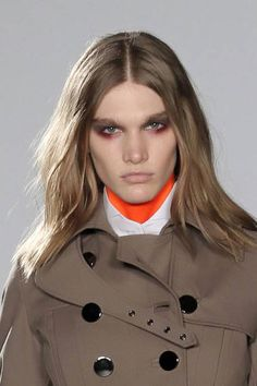 Add mousse to wet hair before blowdrying to create styles that have some natural movement and lift, like at Altuzarra