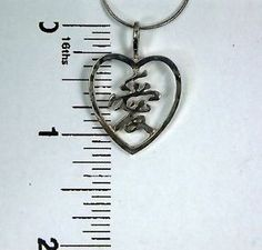 Sterling silver AI or love character in heart frame pendant