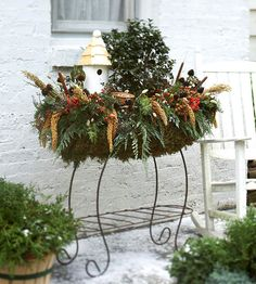 *Outdoor Holiday Decorating with Beautiful Birdhouse Display including food for the birds to eat in the winter.