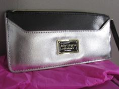 NWT- Betsey Johnson Silver Wristlet/Clutch. Starting at $15