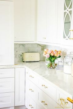 white kitchen - smeg toaster - fresh roses arrangement
