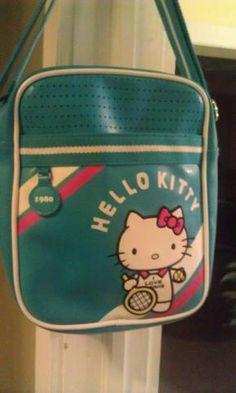 Turquoise blue w red,white trim Hello Kitty