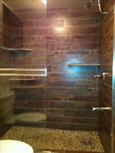 Guest Bathroom Roman Shower.  Pebble Floor and wood tile.  Luxury at its best