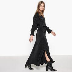 Lange effen jurk met lange mouwen • Model : wijd uitlopend•Lang • Lange mouwen • V-hals• 100% polyester • Wassen op 30° • Geen droogkuis / geen bleekmiddel • Niet in de droogtrommel • Strijken op lage temperatuur