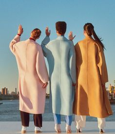 (From left): Cara Taylor, Lineisy Montero, and Jing Wen, all in Mansur Gavriel coats ($1,149–$1,295) and trousers ($495); mansurgavriel.com.