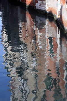 Reflection of brick houses in Venice, Italy.