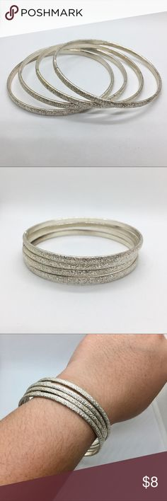 F21 Silver Bangle Set Forever 21 silver bangle set with an aesthetic texture; set of 4  Bundle 3 items for 15% discount! Forever 21 Jewelry Bracelets