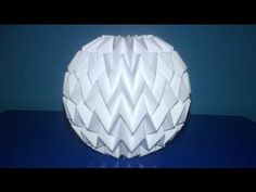 Tutorial 3 - Folding Ball With Pattern Miura (Neospica Neoliveart) Missing details on how to glue the sheet to form the cylinder and on how to attach and set. Origami Paper Folding, Origami And Kirigami, Origami Ball, Origami Stars, Origami Flowers, Origami Boxes, Dollar Origami, Oragami, Origami Lampshade