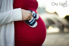 cute little shoes are a GREAT prop for maternity sessions. -- image by John Nettles, Jr of City Light Studio (pictured is Lindsey Nettles, John's wife, and the little bun inside is Parker Elijah - born Feb, 15th 2012!)