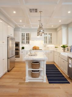 Kitchen Island with White Quartzite Countertop by AGK Design Studio.