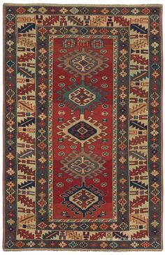"Caucasian Shirvan, 3ft 1in x 4ft 8in, Late 19th Century.   Reflecting the powerful iconography that fascinates many art carpet collectors, this diminutive 19th century rug from Shirvan subgroup is enthralling in its bold candor. Latch hook medallions known as the ""Wheel of Life"" motif ascend its deftly striated soft red field that is strikingly contained by an equally vital chalice-and-oak-leaf main border."
