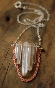 Quartz Crystal Necklace..I like the coloured piece of chain