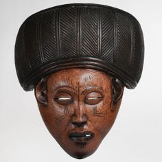 "LUENA MASK, ANGOLA H 31.1 cm  ""This mask with its especially imposing band is of the Pwevo [pwo] type of the Lwena [Luena] who live in the upper Zambeze [Zambezi] region in Angola, Zaire and Zambia. The sculpted band is characteristic of one of the two types of female masks made by these people. The opening at the rear of the mask was probably covered by a fringe of fibers or strips of leather attached to the holes pierc..."" -  the Lwena who have a preference for people with honey-colored…"