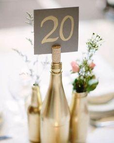 Repurposed wine bottles can be used to display a table number! #WeddingInspiration #WeddingIdeas