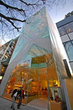 Fronting Omotesando, Tokyo's famous tree-lined boulevard is the slender, L-shaped building for the Italian footwear retailer, Tods. Created by innovative architect Toyo Ito, the seven-story building contains a glass curtain wall block with concrete and steel supporting members, which crisscross and fork out to mimic the shapes of the tall elm trees that stretch along Omotesando Avenue. By japanese architect Toyo Ito, who just won the Pritzker price in architecture, 2013.