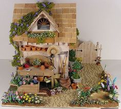 Charming miniature potting shed - could be fun to make something similar and lifting the spirits during long gray days of winter