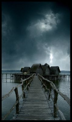 "The dock, sky, and water are EXACTLY how I picture the ""no man's land"" between realms in books 2 and 3..."