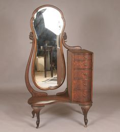 """Vintage quarter sawn oak Deco vanity/dresser with tall side mirror; five vertical serpentine front drawers, curved legs. Documented property of Jean Harlow along with original vintage photograph of the Hollywood star. 60\""""H 31\""""W x 20\""""D. Good condition, original surface. Provenance: From the Indianapolis estate of Ted Z. Leslie."""