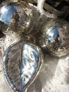 Mercury glass ornaments bring sparkle to everything ... :)