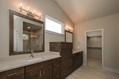Owners Suite: Ceramic tile floors, stained cabinets, marbelite counters, walk-in closet