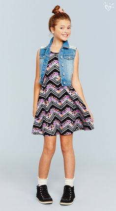 Layer a denim vest over a printed dress for a laid-back spring look. Sneakers: optional but recommended! ;)