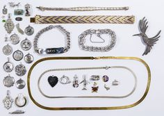 """Lot 560: Sterling Silver Jewelry Assortment; Including (21) charms, (2) necklaces, (4) bracelets, brooch adorned with marcasite and (3) single pierced earrings; most marked """"sterling"""" or """"925"""", a few having gold vermeil finish; together with silver-tone charms and a """"14k"""" gold jewelry part"""
