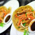 Roasted duck, green coconut & papaya salad, wrapped in handrolled roti with hoisin