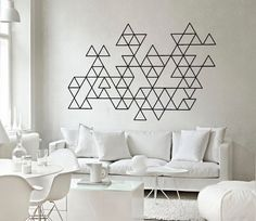 2. Wall Art is an interpretation of the geometric trend that is accessible to all. All you need is a tin of paint, a roll of masking tape and some confidence. Triangles in a stark colour contrast are a simple, yet effective choice.